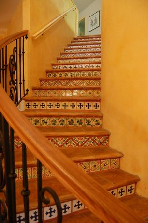 Mediterranean Staircase with High ceiling, curved staircase