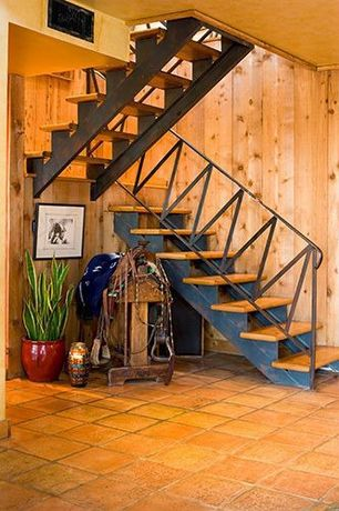 Rustic Staircase with terracotta tile floors, High ceiling