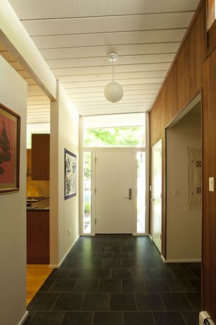 Contemporary Entryway with Transom window, soapstone tile floors, Pendant light, flat door, stone tile floors, Crown molding