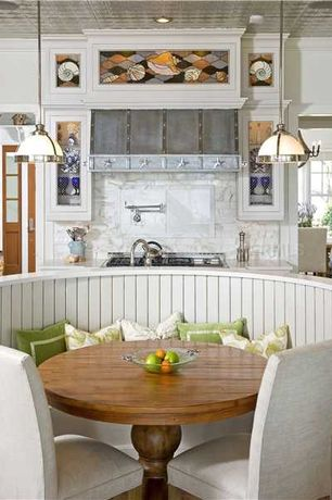 Cottage Kitchen with Glass panel, 17th c. monastery round dining table, Custom zinc range hood, Crown molding, Paint, Flush