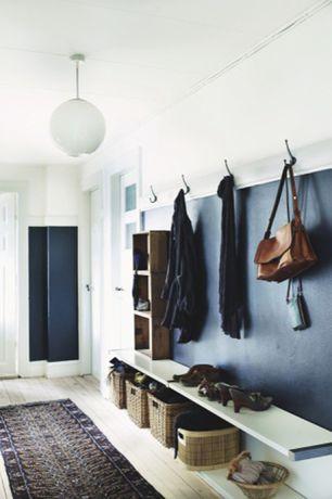 Traditional Mud Room with Hardwood floors, Built-in bookshelf, specialty door, Crown molding, flush light