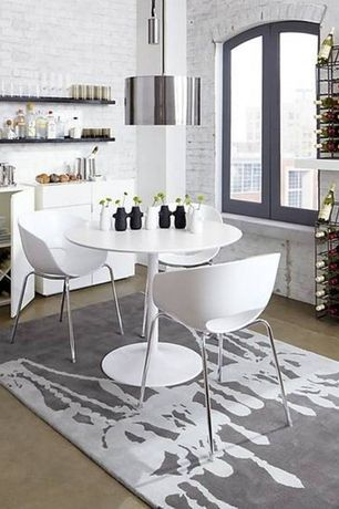 Contemporary Dining Room with Concrete floors, Arched window, High ceiling, Pendant light, Built-in bookshelf, interior brick