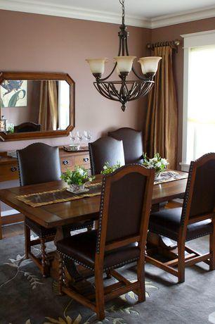Craftsman Dining Room with Hardwood floors, Standard height, Crown molding, Chandelier