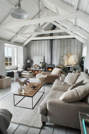 Country Living Room with Exposed beam, Pendant light, Hardwood floors, Reclaimed barn siding, Cathedral ceiling