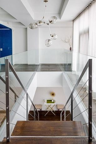 Contemporary Staircase with Hardwood floors, Chandelier, High ceiling, Metal staircase, Exposed beam