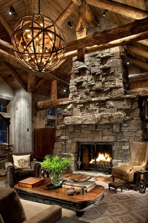 Rustic Living Room with Yosemite Globe Chandelier, stone fireplace, picture window, Tai ping custom rug, double-hung window