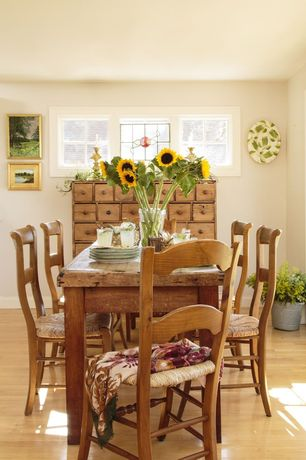 Country Dining Room with Built-in bookshelf, Hardwood floors, Crown molding