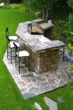 Traditional Patio with exterior stone floors, Outdoor kitchen, Pathway