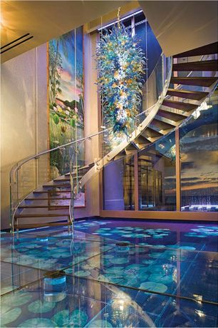 Contemporary Staircase with High ceiling, picture window, Hardwood floors, interior wallpaper, curved staircase