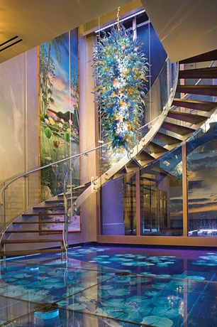 Modern Staircase with Chandelier, Hardwood floors, High ceiling