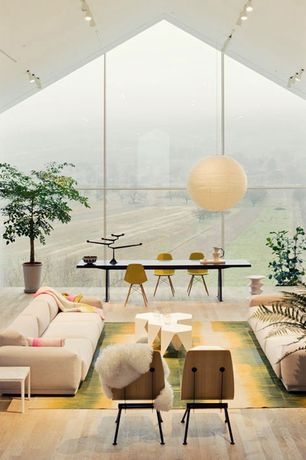 Contemporary Living Room with Hardwood floors, Spring Stool, flush light, AKARI | NOGUCHI LAMP, Mid-Century Slope Chair