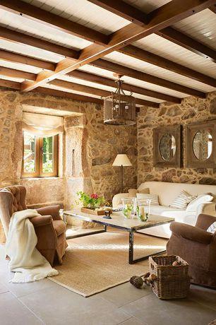 Rustic Living Room with Exposed beam, Pottery barn york slope arm slipcovered sofa, Concrete tile , flush light
