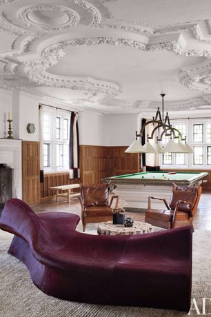 Eclectic Game Room with Pool table, Jeffan coffee table, Cement fireplace, Natural wood wainscoting, Pendant light