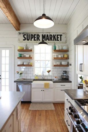 Country Kitchen with Subway Tile, Undermount cast iron apron-front sink, Farmhouse sink, Flat panel cabinets, L-shaped