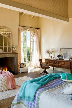 Mediterranean Guest Bedroom with Paint, Paint 1, Hooker furniture danforth writing desk, Fireplace, Concrete floors
