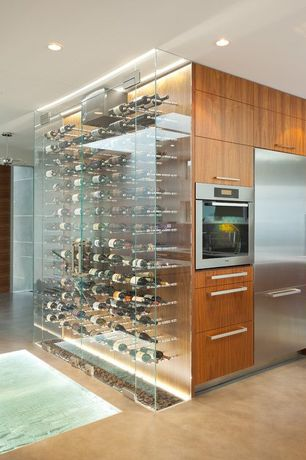 Contemporary Wine Cellar with can lights, Laminate floors, specialty door, Recessed lighting, Built-in bookshelf