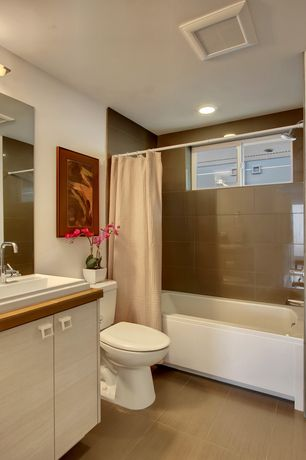 Contemporary Full Bathroom with Vinyl floors, Casement, curtain showerdoor, tiled wall showerbath, Shower, Full Bath, Flush