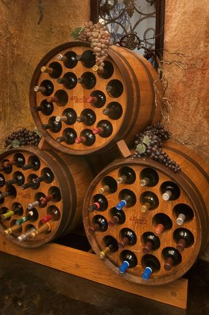 Mediterranean Wine Cellar with Barrel wine rack, MVL Stained Concrete Flooring