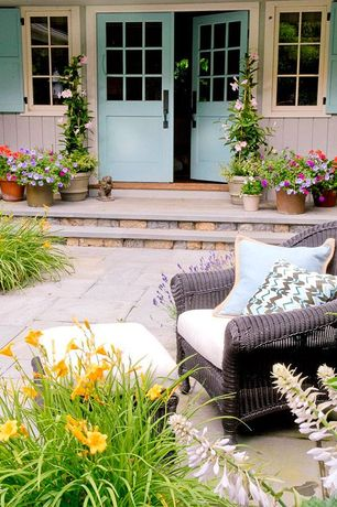 Cottage Front Door with exterior stone floors, South Sea Rattan Saint Tropez Deep Seating Chair with Cushion
