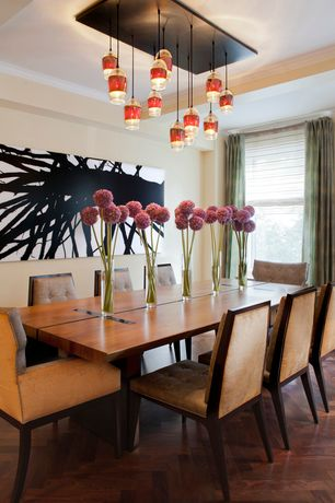 Contemporary Dining Room with Pendant light, Home Essentials 15.75H in. Flair Vase, Hardwood floors, Crown molding