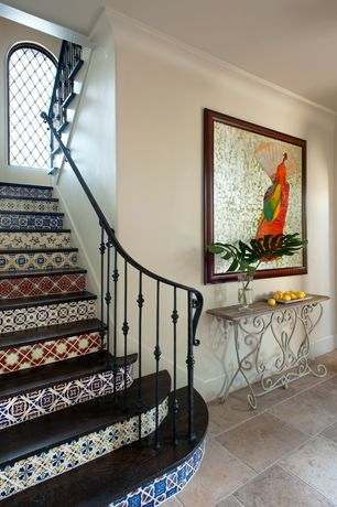 Mediterranean Staircase with Hardwood floors, Arched window, High ceiling, Mexican tile pattern mix