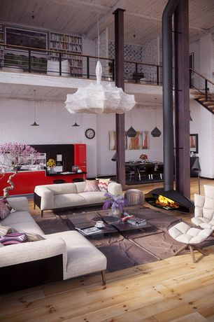 Contemporary Living Room with Hardwood floors, Loft, Columns, Exposed beam, Malm fireplace, High ceiling, Pendant light