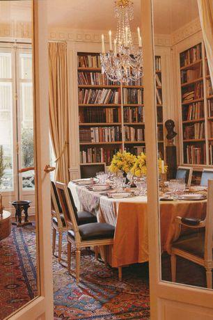 Traditional Dining Room with Built-in bookshelf, Glass panel door, Chandelier, terracotta tile floors