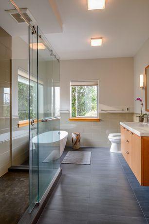 Contemporary Master Bathroom with Flush, Freestanding, Corian counters, frameless showerdoor, flush light, Chair rail