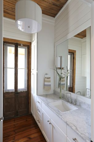 Contemporary Full Bathroom with Flush, Simple marble counters, Rustic wood flooring, Marble countertop, Pendant light