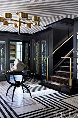 Art Deco Entryway with Hardwood floors, Crown molding, Chandelier, French doors