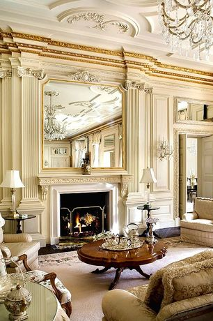 Traditional Living Room with metal fireplace, Paint, Fireplace, Crown molding, Standard height, Chandelier, Cement fireplace