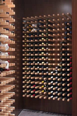 Contemporary Wine Cellar with Built-in bookshelf, complex marble tile floors, stone tile floors, Standard height