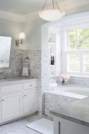Traditional Master Bathroom with Complex Marble Tile, Flat panel cabinets, Complex marble counters, Pendant light, Stone Tile