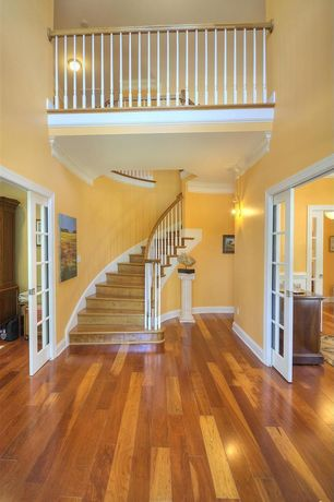 Traditional Entryway with High ceiling, Crown molding, Loft, Hardwood floors, Glass panel door, Wall sconce