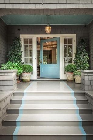 Cottage Front Door with exterior stone floors, Raised beds, Pathway, Paintable white beadboard, exterior tile floors