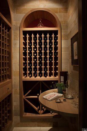Mediterranean Wine Cellar with Built-in bookshelf, travertine tile floors, stone tile floors, High ceiling