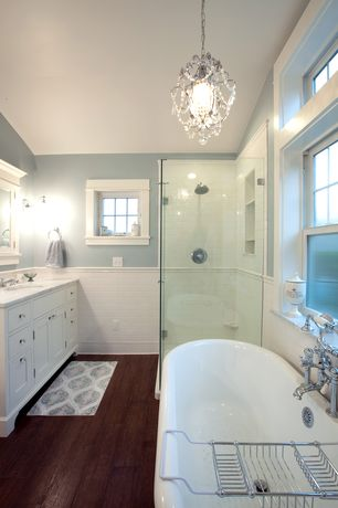 Traditional Master Bathroom with Chandelier, Hardwood floors, Wire Bath Caddy, Complex marble counters, Rain shower