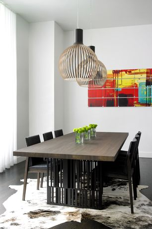 Contemporary Dining Room with Standard height, Pendant light, Hardwood floors