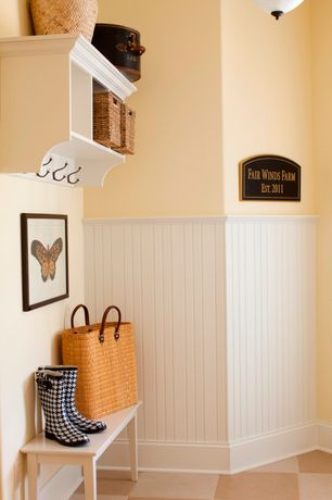 Cottage Mud Room with Built-in bookshelf, Wainscotting, Concrete tile , flush light, Standard height