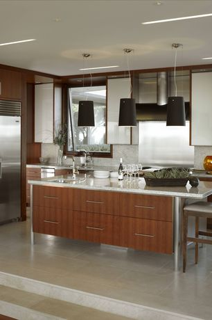 Contemporary Kitchen with two dishwashers, Breakfast bar, Simple granite counters, limestone tile floors, Kitchen island