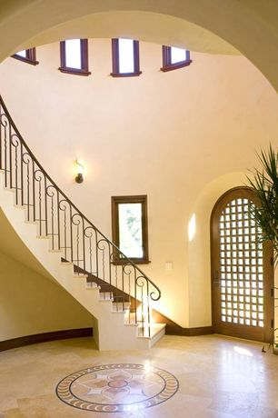 Mediterranean Entryway with specialty door, High ceiling, picture window, Casement, Wall sconce, simple marble floors