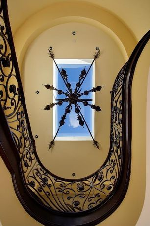 Mediterranean Staircase with Skylight, Chandelier, Cathedral ceiling