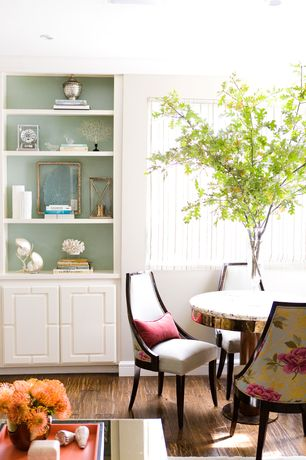 Traditional Dining Room with Hardwood floors, Built-in bookshelf