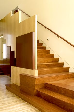 Contemporary Staircase with Hardwood floors, Wood paneling
