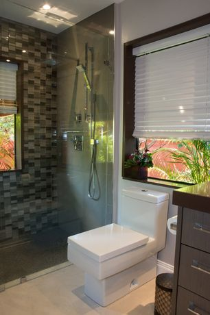 Contemporary Master Bathroom with Casement, stone tile floors, European Cabinets, Handheld showerhead, can lights, Shower