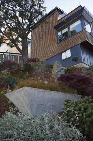 Contemporary Landscape/Yard with Trellis, Fence, Deck Railing, picture window, Casement