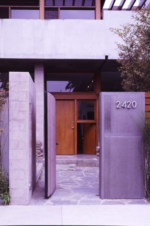 Modern Front Door with Gate, exterior stone floors, Fence, Trellis