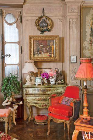 Eclectic Living Room with Hardwood floors, specialty window, Standard height, Crown molding