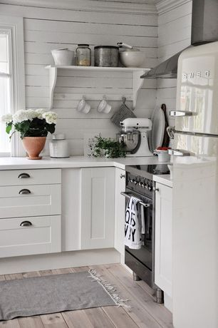 Cottage Kitchen with electric range, Horizontal wood plank wall, L-shaped, Wide plank floors, Wall Hood, Flat panel cabinets