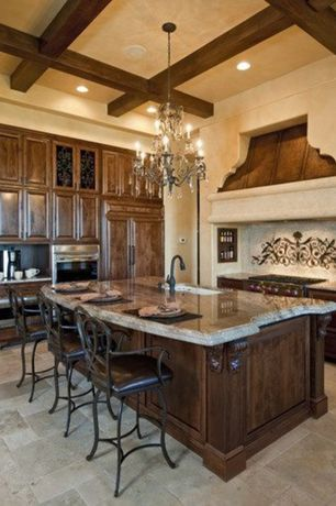 Traditional Kitchen with Raised panel, slate tile floors, Glass panel, Breakfast bar, Chandelier, High ceiling, Exposed beam